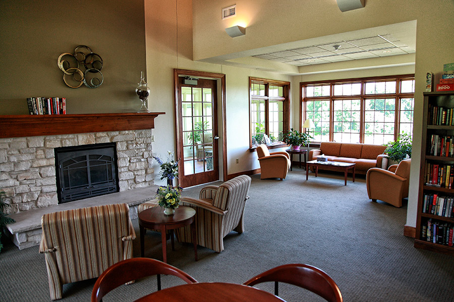 Jack and Engrid Meng hospice residence community area with bright comfy area for reading, inviting fireplace and more.