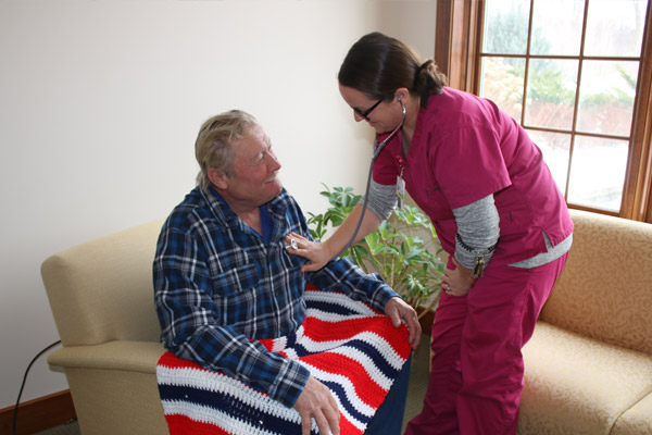 hospice care worker with elderly woman