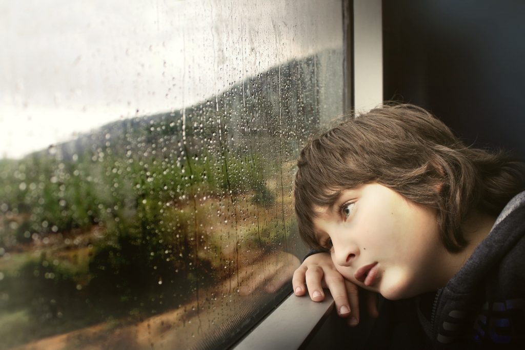 sad child by window